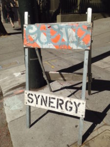 Road sign saying Synergy