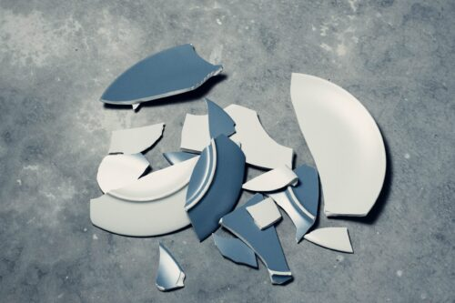 Broken plate against a grey background