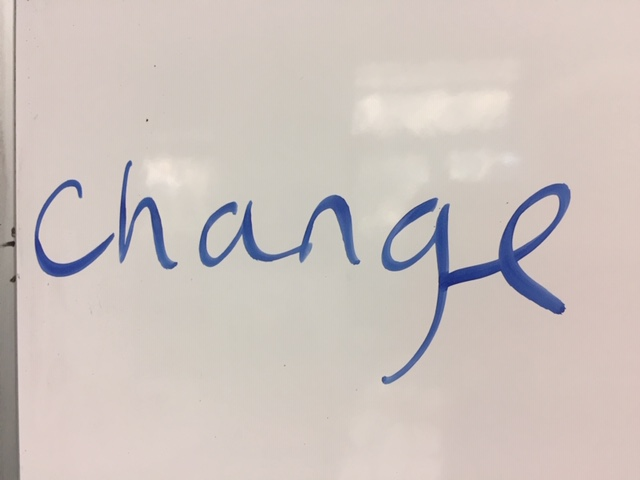 The word change written on a whiteboard